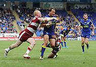 Tyrone Roberts of Warrington Wolves attempts to get through the tackles of Thomas Leuluai and Liam Farrell of Wigan Warriors during the Ladbrokes Challenge Cup Quarter Final match at the Halliwell Jones Stadium, Warrington.<br /> Picture by Michael Sedgwick/Focus Images Ltd +44 7900 363072<br /> 02/06/2018