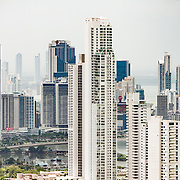 The skyscrapers of the new Panama City skyline as seed from the top of Ancon Hill. Ancon Hill is only 654-feet high but commands an impressive view out over the new and old sections of Panama City. With views out over both the Pacific Ocean and the entrance to the Panama Canal, the area was historically where the administration of the Panama Canal was centered and now has a mix of high-end residences and government departments.
