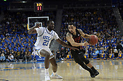 Nov 15, 2019; Los Angeles, CA, USA; UNLV Rebels guard Elijah Mitrou-Long (55) is defended by UCLA Bruins guard Prince Ali (23) in the first half at Pauley Pavilion. UCLA defeated UNLV 71-54.