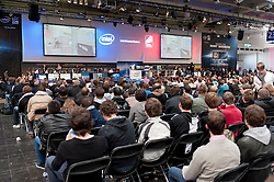 Crowd watching Intel Exteme Master computer gaming competition at CeBIT 2011 digital and electronics trade fair in Hannover March 2011 Germany
