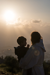 20 April 2019, Jerusalem: Rev. Jeni Falkman Grangaard and her two-and-a-half-year-old son Amos share a moment after an Easter Sunday sunrise service at Jabal Allah (God's Mountain) on the Mount of Olives in Jerusalem, held by the Lutheran Church of the Redeemer (English-speaking congregation).