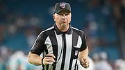 Aug 22, 2019; Miami Gardens, FL USA;  NFL Line Judge Mark Stewart (79) takes the field during an NFL preseason game at Hard Rock Stadium. The Dolphins beat the Jaguars 22-7. (Kim Hukari/Image of Sport)