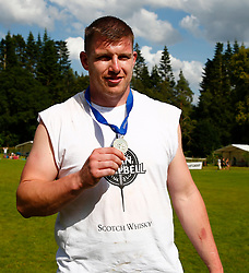 The Caber World Championship was once again held at Inveraray Highland Games.The winner Lorne Colthart, the first Scot to win this Chanpionship since 2002, being presented with his medal by Donald Clark sponsor of this competition..... (c) Stephen Lawson | Edinburgh Elite media
