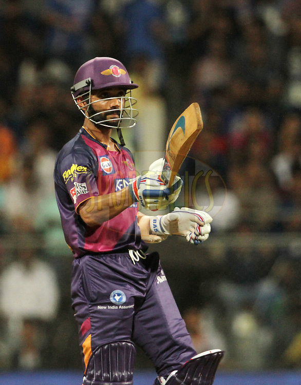 Rising Pune Supergiants player Ajinkya Rahane raises his bat after scoring a fifty during match 1 of the Vivo Indian Premier League ( IPL ) 2016 between the Mumbai Indians and the Rising Pune Supergiants held at the Wankhede Stadium in Mumbai on the 9th April 2016<br /> <br /> Photo by Vipin Pawar/ IPL/ SPORTZPICS