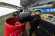 Ground staff at the Pirelli Stadium work hard to clear water which has accumulated due to heavy rainfall, prior to the the EFL Sky Bet Championship match between Burton Albion and Middlesbrough at the Pirelli Stadium, Burton upon Trent, England on 2 April 2018. Picture by Richard Holmes.