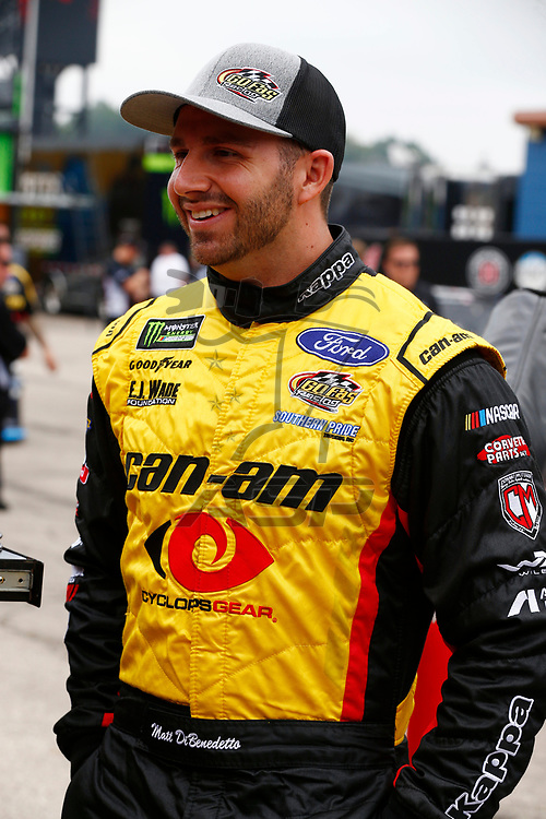 Matt DiBenedetto (32) hangs out in the garage during practice for the Consumers Energy 400 at Michigan International Speedway in Brooklyn, Michigan.