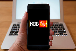 Using iPhone smart phone to display website logo of NBB, National Bank of Bahrain