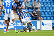 Carlisle United's Danny Grainger makes a tackle Colchester United's Brandon Hanlan(21) during the EFL Sky Bet League 2 match between Colchester United and Carlisle United at the Weston Homes Community Stadium, Colchester, England on 14 October 2017. Photo by Phil Chaplin