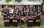 Members of the Minidoka Swing Band pose for a group photo on the grounds of Washington Country Museum, Hillsboro, Oregon