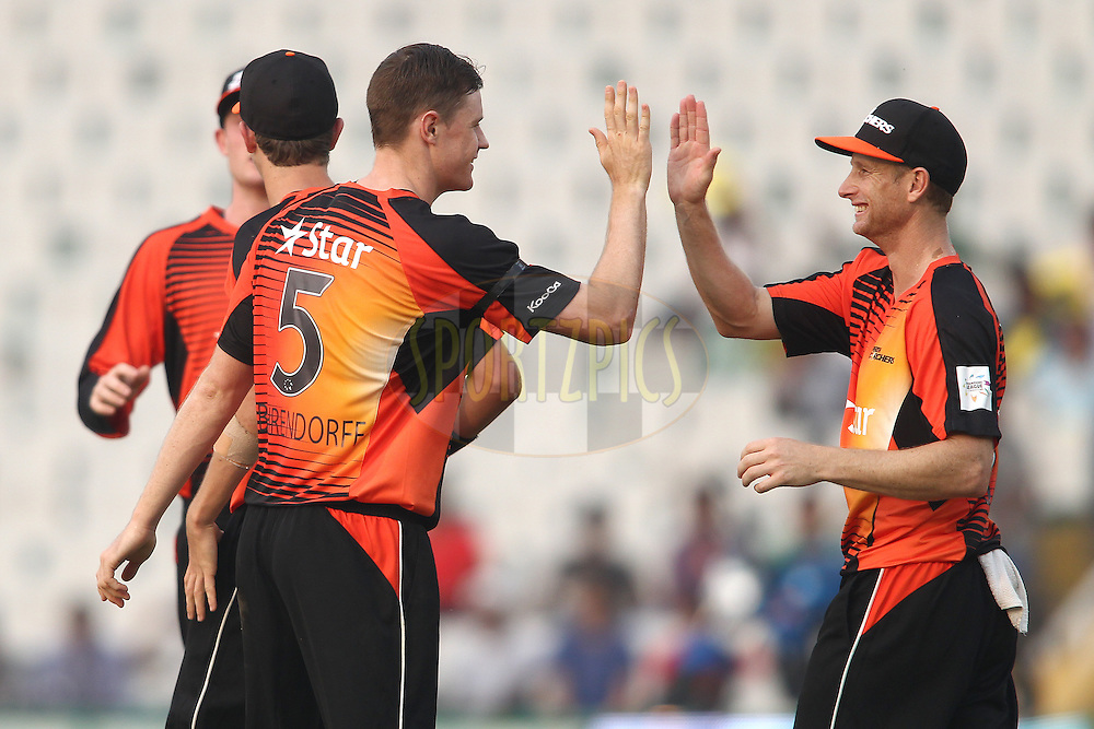 Jason Behrendorff of the Perth Scorchers is congratulated by Perth Scorchers captain Adam Voges for getting Vaughn van Jaarsveld of the Dolphins wicket during match 4 of the Oppo Champions League Twenty20 between the Dolphins and the Perth Scorchers held at the Punjab Cricket Association Stadium, Mohali, India on the 20th September 2014<br /> <br /> Photo by:  Shaun Roy / Sportzpics/ CLT20<br /> <br /> <br /> Image use is subject to the terms and conditions as laid out by the BCCI/ CLT20.  The terms and conditions can be downloaded here:<br /> <br /> http://sportzpics.photoshelter.com/gallery/CLT20-Image-Terms-and-Conditions-2014/G0000IfNJn535VPU/C0000QhhKadWcjYs