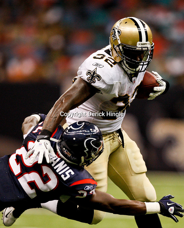 August 21, 2010; New Orleans, LA, USA; New Orleans Saints running back P.J. Hill (32) is tackled by Houston Texans cornerback Sherrick McManis (22)during the second half of a 38-20 win by the New Orleans Saints over the Houston Texans during a preseason game at the Louisiana Superdome. Mandatory Credit: Derick E. Hingle
