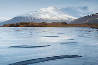 The frozen Lake Þveit and Mount Hoffellsfjall in background. Southeast Iceland.