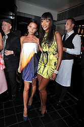 Left to right, VICTORIA BECKHAM and NAOMI CAMPBELL at a dinner hosted by Alexandra Shulman editor of British Vogue in association with Net-A-Porter.com to celebrate 25 years of London Fashion Week and Nick Knight held at Le Caprice, Arlington Street, London on 21st September 2009.