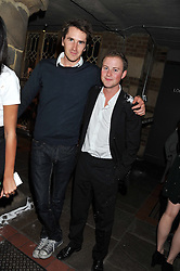 Left to right, OTIS FERRY and GUY PELLY at a party at the nightclub Public, King's Road, London to celebrate the launch of Public Verbier held on 17th November 2011.
