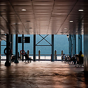 July 27, 2009 - Bronx, NY : West Side by Water.                                     People lounge inside the Yonkers ferry terminal shortly before the 7:27 New York Water Taxi arrives. The ferry service, proposed for Riverdale, would ferry passengers to southern Manhattan--a West-side alternative to Metro North, which routes commuters through the crowded Grand Central Terminal on the East side.