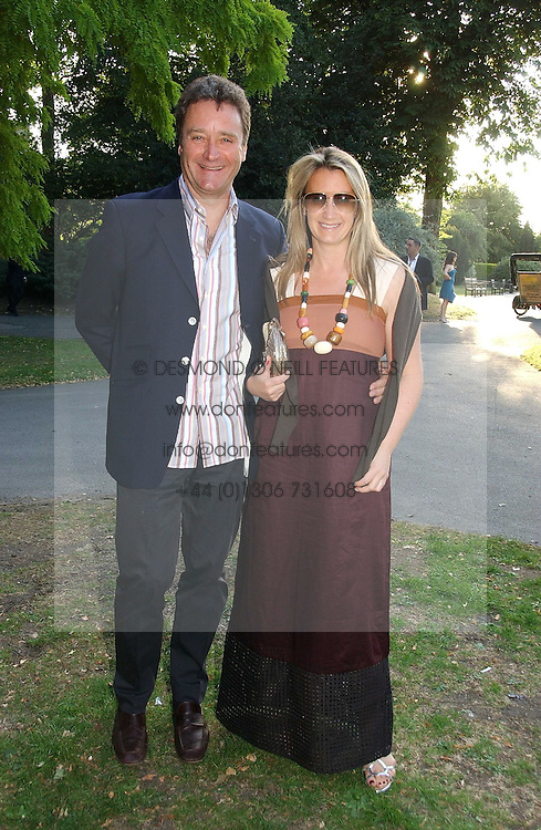Handbag designer ANYA HINDMARSH and her husband JAMES SEYMOUR at the Concervative Party Summer Party held in the gardnes of The Royal Hospital, Chelsea, London on 3rd July 2006.<br />