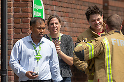 Two Managers of the Asda supermarket emerge from the building after an escorted visit to their store to assess the damage at the scene of a fire at The Mall in Walthamstow in North East London, that broke out during rush hour this morning and appears to have destroyed the foodcourt and according to a manager escorted by LFB officials at the adjacent Asda, a large amount of stock. London, July 22 2019.