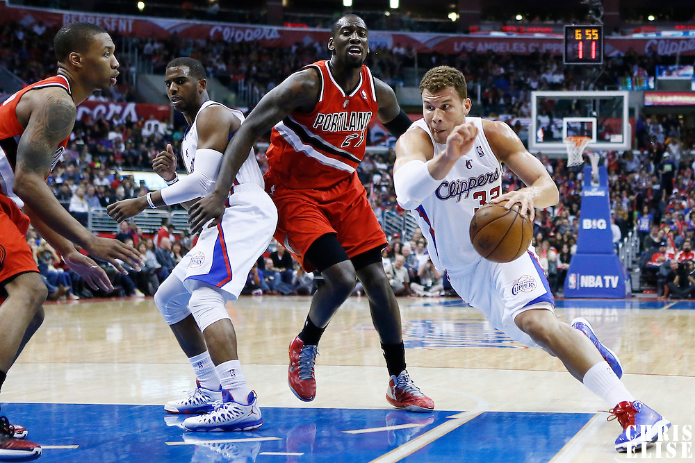 16 April 2013: Los Angeles Clippers power forward Blake Griffin (32) drives past Portland Trail Blazers center J.J. Hickson (21) during the Los Angeles Clippers 93-77 victory over the Portland Trail Blazers at the Staples Center, Los Angeles, California, USA.