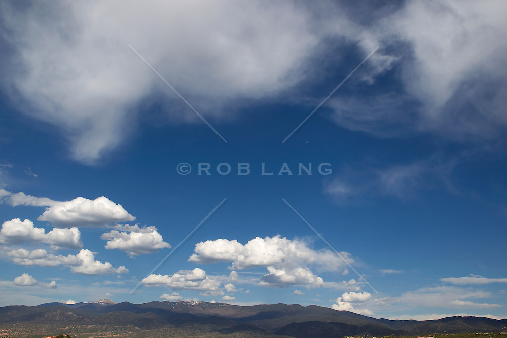 beautiful cloud formations over the Santa Fe Mountains of New Mexico