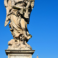 Angel With The Whips Statue on Ponte Sant&rsquo;Angelo in Rome, Italy<br /> The Ponte Sant&rsquo;Angelo is also called the Bridge of Angels because of the 10 stunning sculptures that flank its 443 foot length. These statues were commissioned in 1669 and designed by Gian Bernini.  Each one depicts a scene from the persecution and crucifixion of Christ. The Angel with the Whips is the second in the series. It was sculpted by Lazzaro Morelii. Look closely and you&rsquo;ll see your first glimpse of the dome atop St. Peter&rsquo;s Basilica.