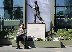 Andy Murray of Great Britain poses with the Gentlemen's Singles Trophy next to the Fred Perry statue at Wimbledon <br /> London, United Kingdom, <br /> Monday July 08, 2013. <br /> Photo by: Roger Allen / i-Images