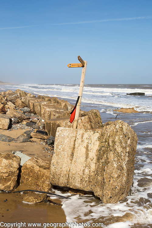 March 20 2018 Hemsby, UK. Coast path sign left abandoned by coastal erosion at Hemsby, Norfolk, England, UK