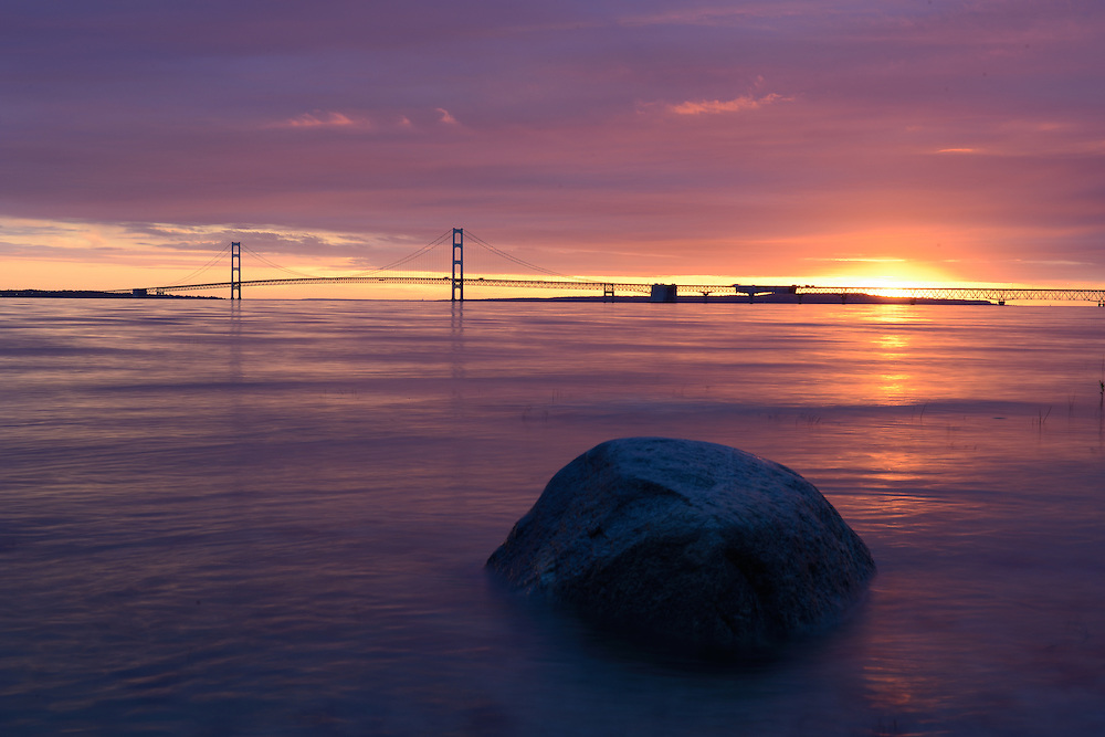 A dramatic summer sunrise over the Mackinac Bridge.<br />