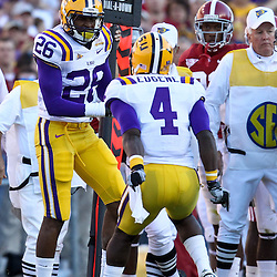 November 6, 2010; Baton Rouge, LA, USA; LSU Tigers cornerback Tharold Simon (26) celebrates with cornerback Jai Eugene (4) following a defensive stop against the Alabama Crimson Tide during the second half at Tiger Stadium. LSU defeated Alabama 24-21.  Mandatory Credit: Derick E. Hingle