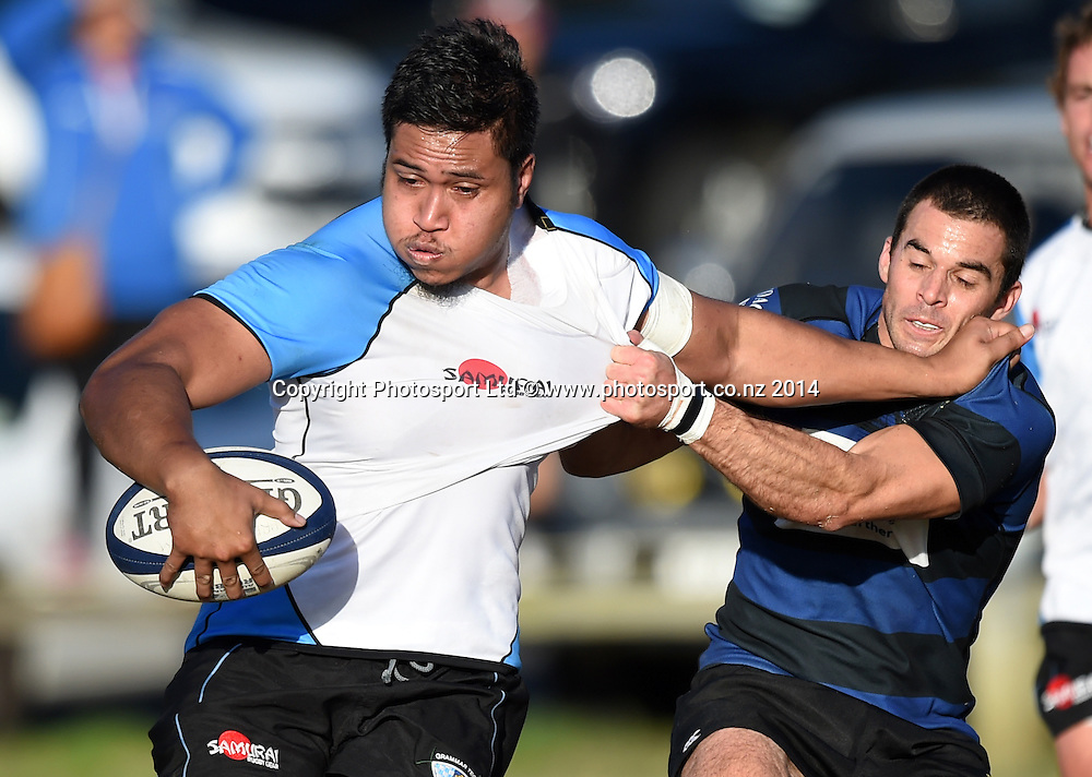 Grammar prop Tavita Milo is tackled by Ponosnby's Murray Williams. Grammar TEC v Ponsonby. Auckland Premier Club Rugby. Alan McEvoy Memorial Shield. Auckland, New Zealand. Saturday 9 May 2015. Copyright Photo: Andrew Cornaga / www.Photosport.co.nz