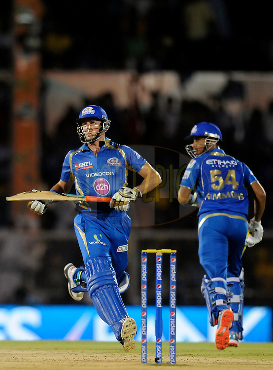 Michael Hussey of the Mumbai Indians and Lendl Simmons of the Mumbai Indians run between the wickets during the eliminator match of the Pepsi Indian Premier League Season 2014 between the Chennai Superkings and the Mumbai Indians held at the Brabourne Stadium, Mumbai, India on the 28th May  2014<br /> <br /> Photo by Pal PIllai / IPL / SPORTZPICS<br /> <br /> <br /> <br /> Image use subject to terms and conditions which can be found here:  http://sportzpics.photoshelter.com/gallery/Pepsi-IPL-Image-terms-and-conditions/G00004VW1IVJ.gB0/C0000TScjhBM6ikg