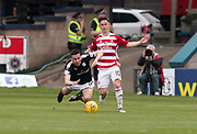 5th May 2018, Dens Park, Dundee, Scotland; Scottish Premier League football, Dundee versus Hamilton Academical; Daniel Redmond of Hamilton Academical brings down Cammy Kerr of Dundee