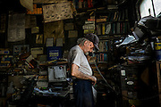 "Angelo ""Tubby"" Galzarano, 79, speaks to a customer on the phone in his repair shop, Tubby's Auto Service, in West Aliquippa, Pennsylvania, USA on June 5, 2015. Galzarano has worked and lived in West Aliquippa his entire life."