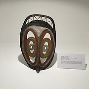 Yam Mask   (20th century)<br /> Abelam People, Sepik River Region, Papau New Guinea<br /> Woven plant fiber and pigment<br /> Gift of Martha and Robert Fogelman <br /> 2008.2.166<br /> <br /> The yam (a tuber similar to the sweet potato) is the staple of the Abelam diet and important to their daily life and survival.  Village men wear yam masks at festivals when yams are planted and before the crop is harvested.  During the ceremonies, the Abelam ask their ancestor spirits to provide an abundant crop of yams to each village.