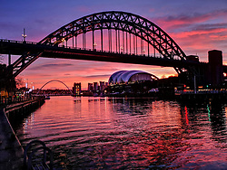 © Licensed to London News Pictures. 02/01/2020. Newcastle, UK. A bright sunrise on a winter morning over the River Tyne in Newcastle, north east England, with the Tyne Bridge (front), Sage music hall (right) and Millennium Bridge (left) pictured. Photo credit: Colin Scarr/LNP