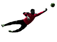 one  soccer player goalkeeper man punching ball in silhouette isolated white background