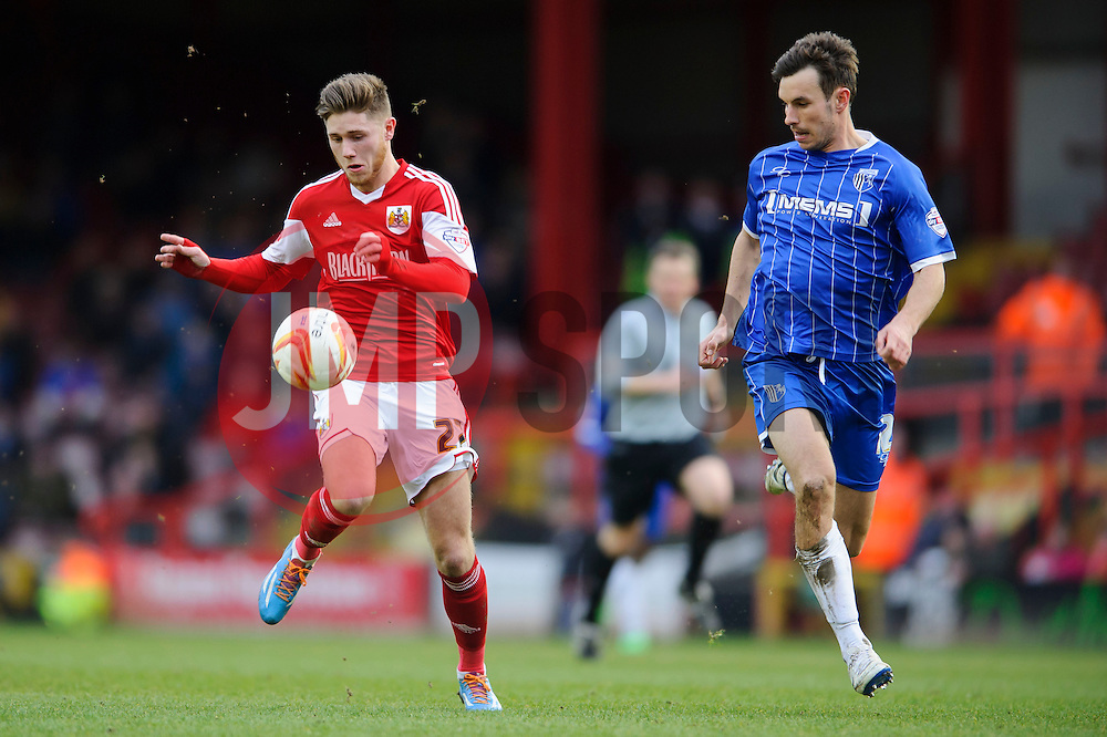 Bristol City Forward Wes Burns (WAL) is challenged by Gillingham Midfielder Steven Gregory (ENG) - Photo mandatory by-line: Rogan Thomson/JMP - 07966 386802 - 01/03/2014 - SPORT - FOOTBALL - Ashton Gate, Bristol - Bristol City v Gillingham - Sky Bet League One.