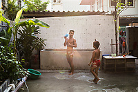 A young man takes a break from training at Sor Dechapant Gym in Bangkok, Thailand. In recent years, combat sports--especially Muay Thai--have been seen as a crucial elements in successful Mixed Martial Arts fighting.