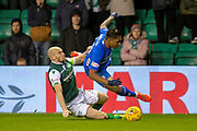 David Gray (#2) of Hibernian FC tackles Alfredo Morelos (#20) of Rangers FC during the Ladbrokes Scottish Premiership match between Hibernian and Rangers at Easter Road, Edinburgh, Scotland on 8 March 2019.