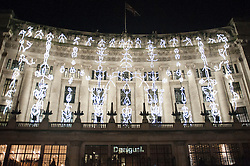 "© Licensed to London News Pictures. 14/01/2016. London, UK. ""Keyframes"" by Groupe LAPS / Thomas Veyssière projected onto the Liberty store building.  The work forms part of Lumiere London, a major new light festival which commenced today to be held over four evenings and featuring artists who work with light.  The event is produced by Artichoke and supported by the Mayor of London.  Photo credit : Stephen Chung/LNP"