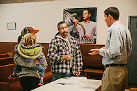 LaFollette, TN - Nov. 14, 2013: Andrew Hamblin, right, pastor of the Tabernacle Church of God, talks with Jeff and Tiffany Nuchols as they signed a petition supporting the church's right to handle serpents. The church, whose congregation regularly handles snakes as part of services, had their snakes confiscated in early November by the Tennessee Wildlife Resources Agency for violating a Tennessee law against handling serpents in church. <br /> <br /> Photo by Shawn Poynter
