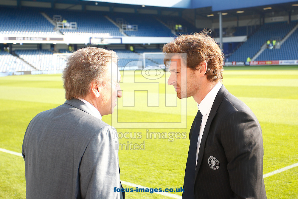 Picture by Andrew Tobin/Focus Images Ltd. 07710 761829. 23/10/11. Neil Warnock, manager of QPR (L) and Andre Villas Boas, manager of Chelsea (R) talk before the Barclays Premier League match between QPR and Chelsea at Loftus Road, London.