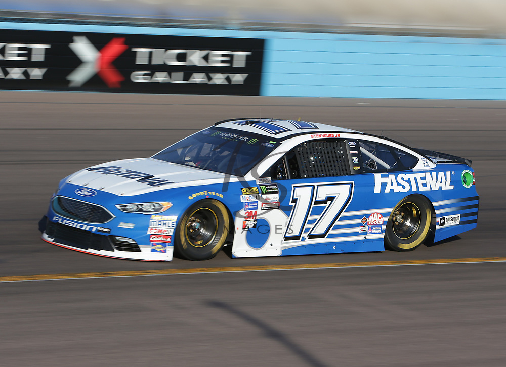 Ricky Stenhouse Jr. qualifies for Sunday's NASCAR Cup Series auto race on Friday, March 17, 2017, in Avondale, Ariz.  (AP Photo/Rick Scuteri)