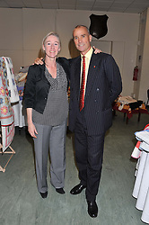 LT.COL.HENRY WORSLEY and KATY EMCK CEO of Fine Cell Work at a reception to view and buy cushions, quilts, bags and gifts Hand-stitched in British prisons held at The Riffles Club, 56 Davies Street, London W1 on 26th April 2012.
