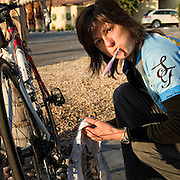 Christine Jerko performing preventative maintenance before a day-long training ride. United Finance (formerly Finnegan's Toys / Discover Chiropractic) Cycling Team winter training camp, January 30 to February 5, 2010; Palm Springs, California.  Emerald Velo Cycling Club (EVCC).