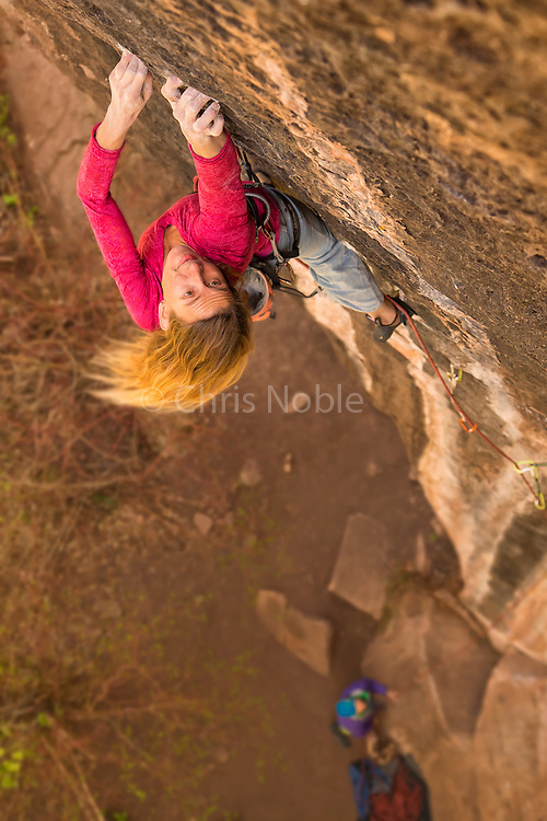 "Lisa Hathaway climbing ""The Bleeding"" rated 14-, Mill Creek Canyon Utah."