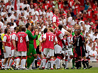 Photo: Daniel Hambury.<br />Arsenal v Ajax. Dennis Bergkamp Testimonial. 22/07/2006.<br />Arsenal's Dennis Bergkamp is hoisted onto the shoulders of players from both sides.