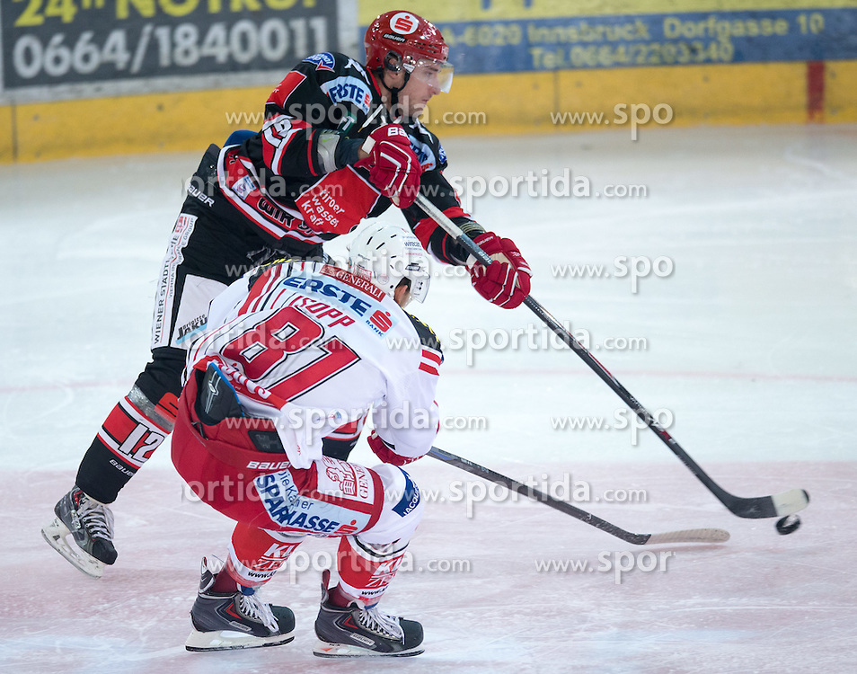 14.09.2014, TWK Arena, Innsbruck, AUT, EBEL, HC TWK Innsbruck die Haie vs EC KAC, 2. Runde, im Bild (v.l.) Andreas Valdix (Innsbruck), Maximilian Isopp (EC KAC) // during the Erste Bank Icehockey League 2nd round match between HC TWK Innsbruck Die Haie and EC KAC at the TWK Arena in Innsbruck, Austria on 2014/09/14. EXPA Pictures © 2014, PhotoCredit: EXPA/ Johann Groder