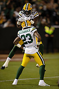 Green Bay Packers rookie cornerback Jaire Alexander (23) celebrates with leaping Green Bay Packers rookie cornerback Josh Jackson (37) after intercepting a second quarter pass that gives the Packers the ball at their own 7 yard line and stopping a deep Raiders drive during the 2018 NFL preseason week 3 football game against the Oakland Raiders on Friday, Aug. 24, 2018 in Oakland, Calif. The Raiders won the game 13-6. (©Paul Anthony Spinelli)