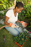 Woman Watering New Plants