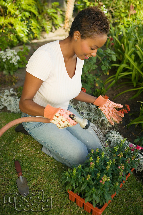 Woman Watering New Plants